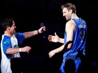 Dallas Mavericks owner Mark Cuban (left) honors forward Dirk Nowitzki (right) during a post game ceremony at the American Airlines Center in Dallas, Tuesday, April 9, 2019. Dirk is playing in his last home game of his 21st season with the team.