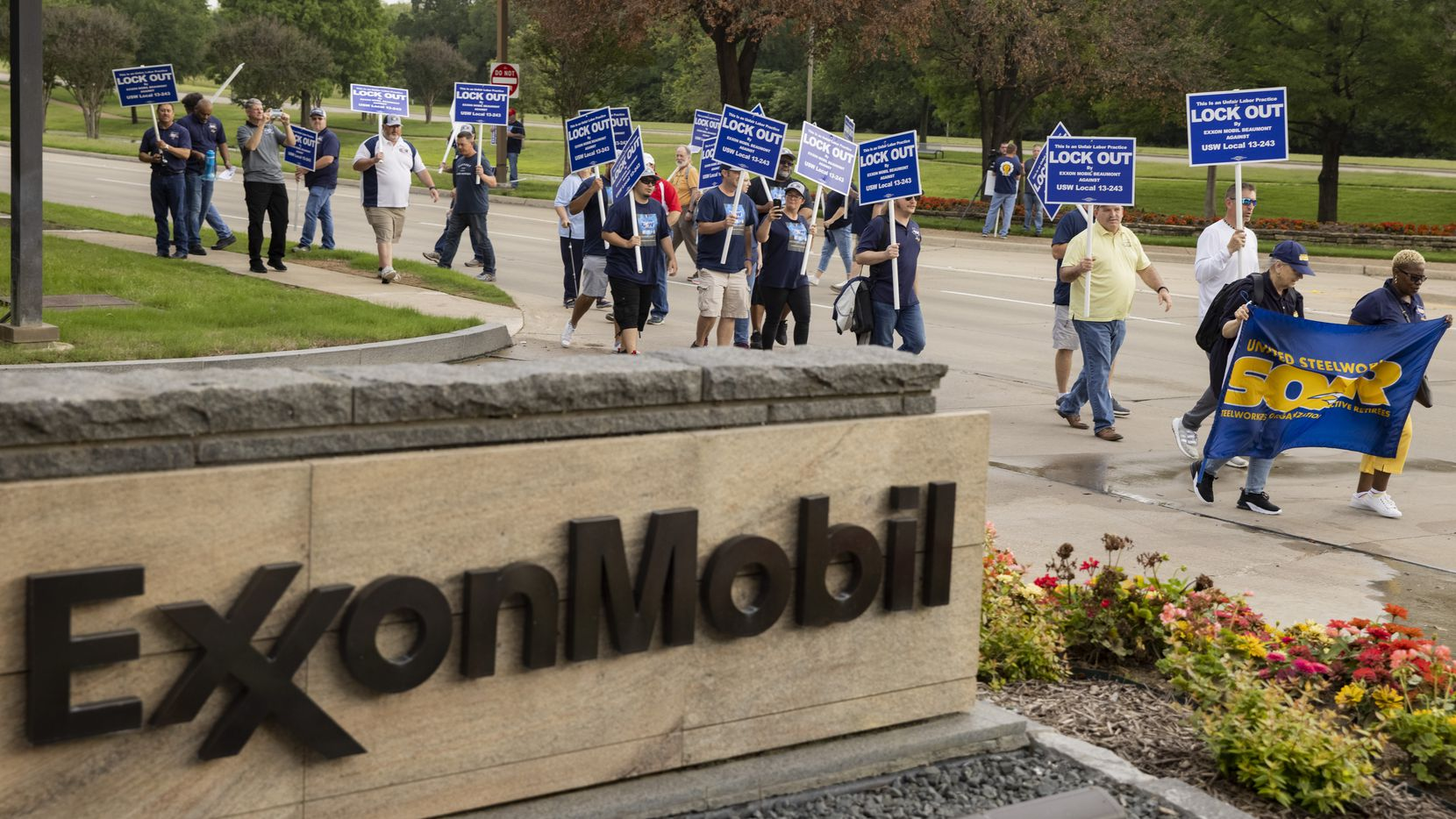 ExxonMobil workers and union activists protest outside of the ExxonMobil headquarters during the company's shareholder meeting on Wednesday, May 26, 2021, in Irving. (Juan Figueroa/The Dallas Morning News)
