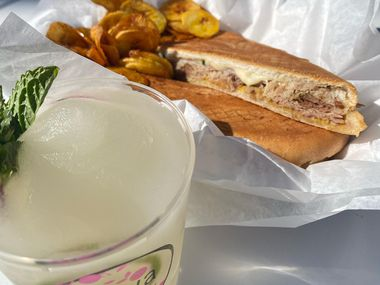 A Cuban sandwich, plantain chips and a frozen mojito await at The Guava Tree in McKinney.
