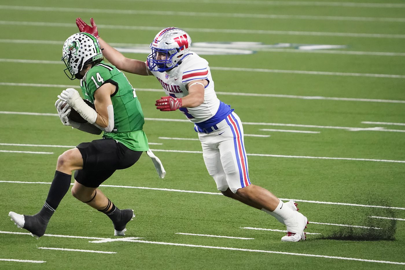 Southlake Carroll wide receiver Brady Boyd (14) catches a pass on a 49-yard touchdown past Austin Westlake defensive back Jax Crockett during the first quarter of the Class 6A Division I state football championship game at AT&T Stadium on Saturday, Jan. 16, 2021, in Arlington, Texas.