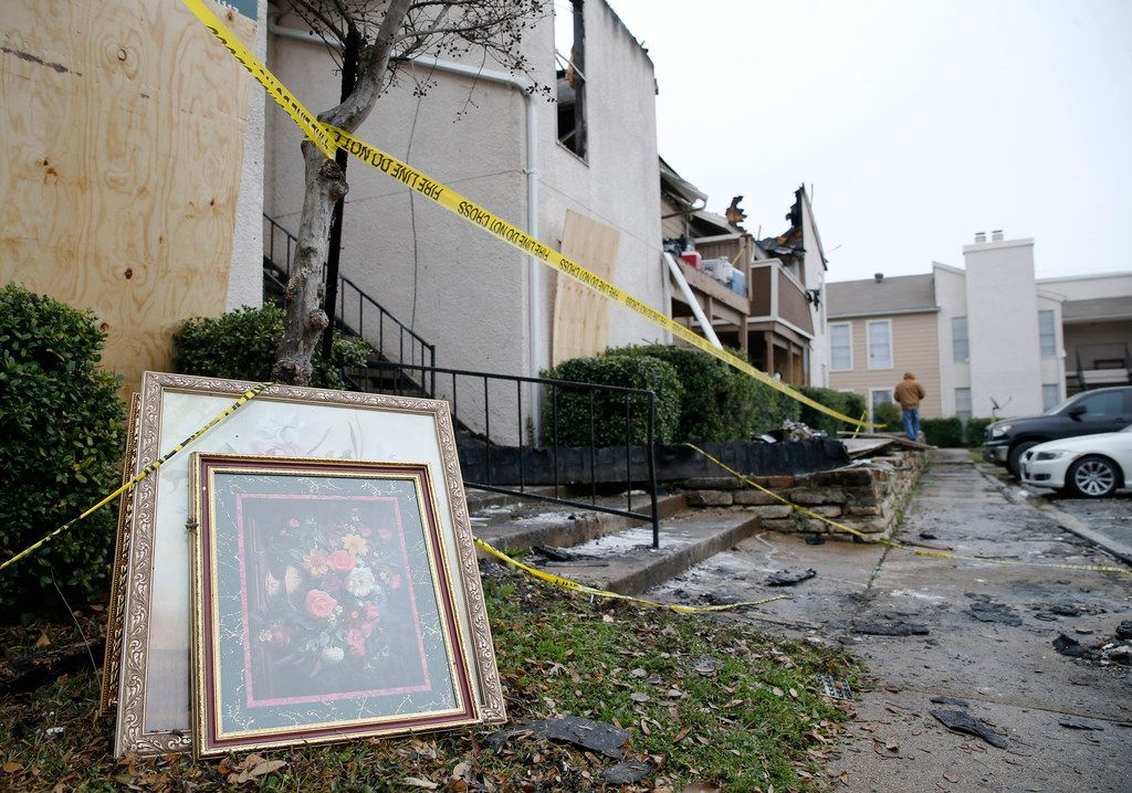 Artwork sits outside of an apartment unit after a fire damaged eight units at Del Rey Village Apartments in Dallas on Friday, March 1, 2019.