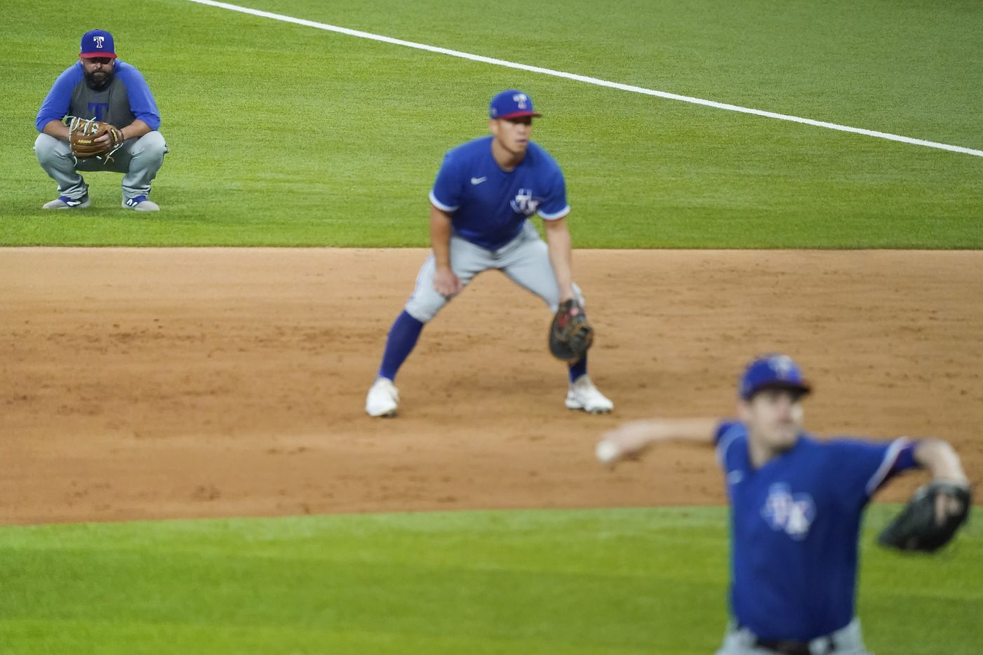 Texas Rangers infield coordinator Kenny Holmberg watches from the field as Jason Bahr pitches and Rob Refsnyder plays at first base during a game between players at the team's alternate training site at Globe Life Field on Saturday, Sept. 19, 2020.