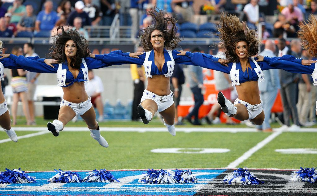 Dallas Cowboys cheerleaders perform before the Hall of Fame Game between the Dallas Cowboys and Arizona Cardinals at Tom Benson Hall of Fame Stadium in Canton, Ohio on Thursday, August 3, 2017. (Vernon Bryant/The Dallas Morning News)
