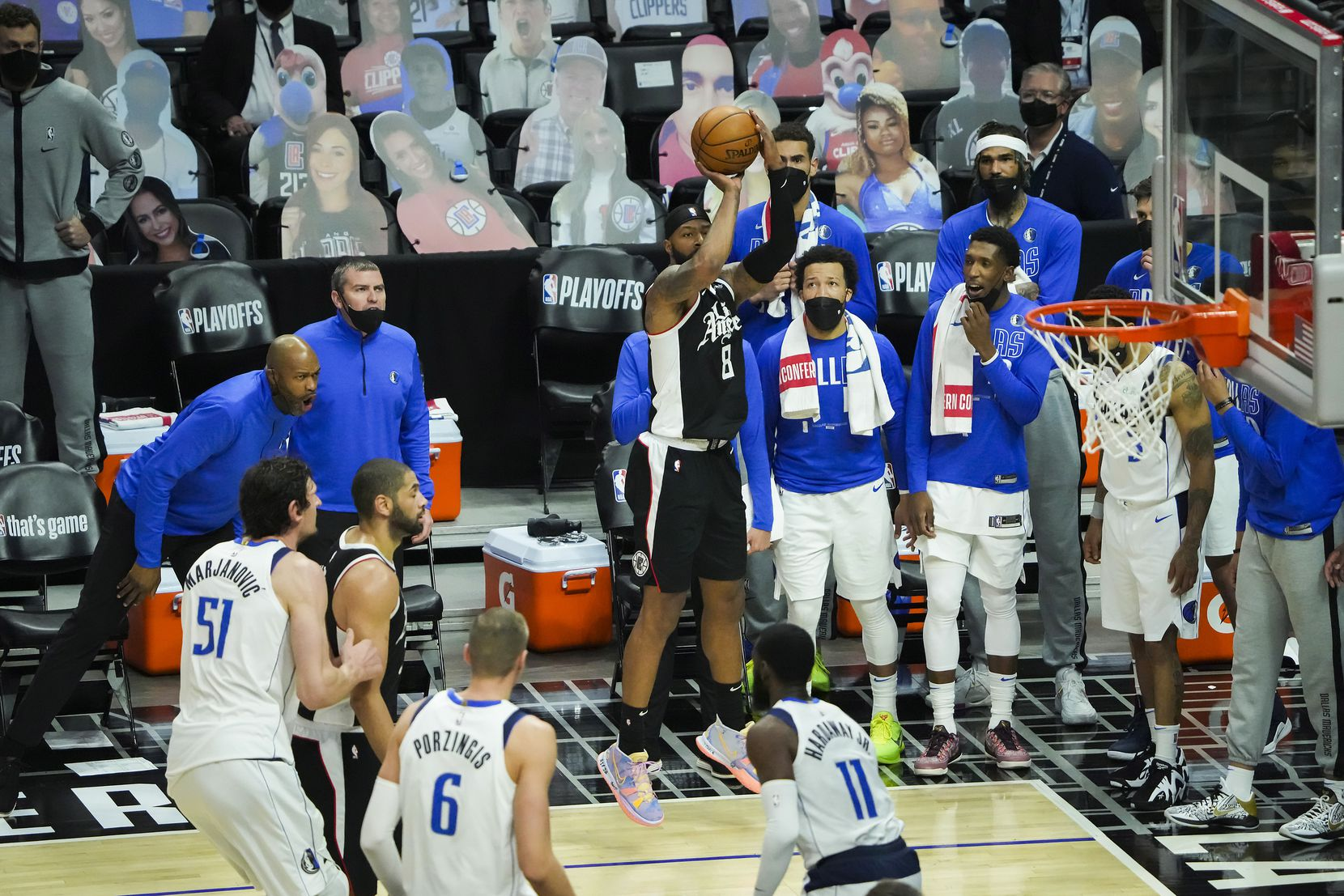 LA Clippers forward Marcus Morris Sr. (8) hits a 3-pointer from the corner in front of the Dallas Mavericks bench during the fourth quarter of Game 7 of an NBA playoff series at the Staples Center on Sunday, June 6, 2021, in Los Angeles.