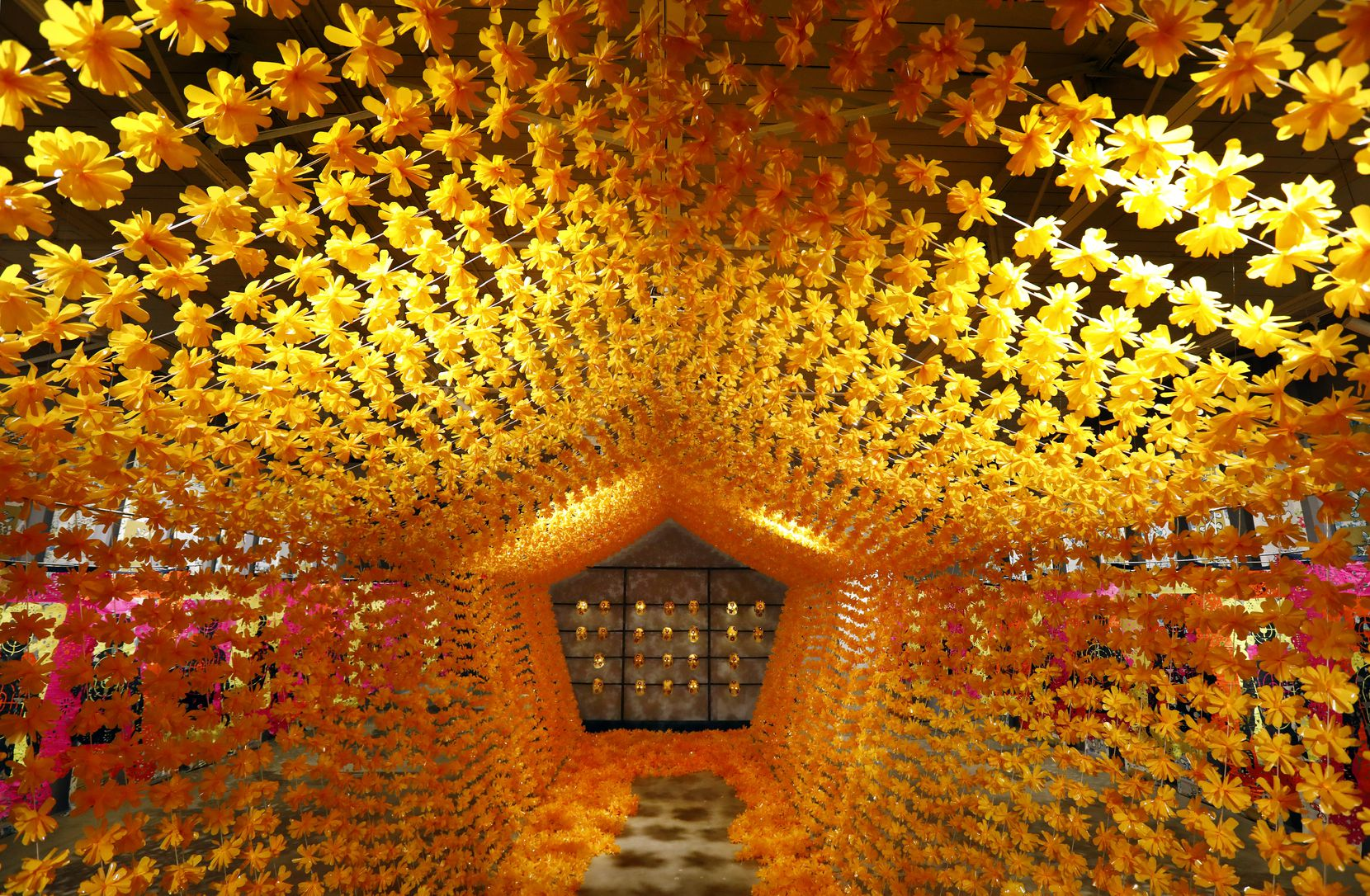 The pentagon-shaped 'Flower Tunnel,' 2019 leads visitors to a tribute to the dead as part of Mexican artist Betsabeé Romero's 'An Altar in Their Memory / Un Altar en Su Memoria' exhibit.