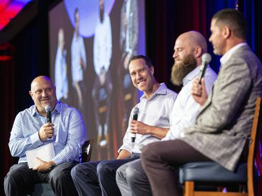 Texas Rangers beat writer Evan Grant, left, asks former players David Murphy, second from left, Mike Napoli, third from left, and Michael Young their favorite Globe Life Park memory during the Texas Rangers all-time team luncheon at Live by Loews Hotel in Arlington Friday, September 27, 2019.