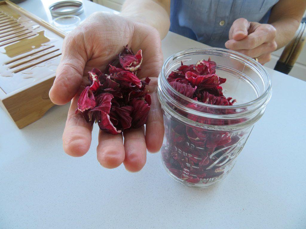 Annie Favia-Erickson holds organic Hibiscus tea leaves that she sells under the Erda Tea label.