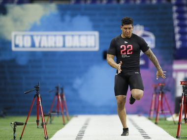 Utah defensive lineman Bradlee Anae runs the 40-yard dash at the NFL football scouting combine in Indianapolis, Saturday, Feb. 29, 2020. (AP Photo/Charlie Neibergall)