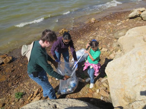 Volunteers gather trash near a lake. Irving is recruiting volunteers for its annual Trash-Off on April 10.