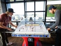 Dallas Stars players Ty Dellandrea (left) and Joe Pavelski play bubble hockey during a break from the ice on Sept. 17, 2020 while awaiting an opponent in the 2020 Stanley Cup FInal in Edmonton, Alberta.