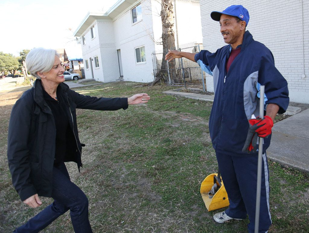 The Human Impact advocate Jennifer Jorns greets Willie Hodge as she stops by to visit him on the job.