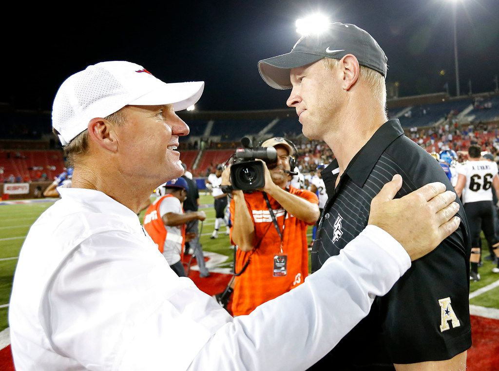 Southern Methodist head coach Chad Morris, left, talks with UCF head coach Scott Frost after the visiting Knights' 31-24 win at Gerald J. Ford Stadium in Dallas on Saturday, Nov. 4, 2017. (Jae S. Lee/Dallas Morning News/TNS)