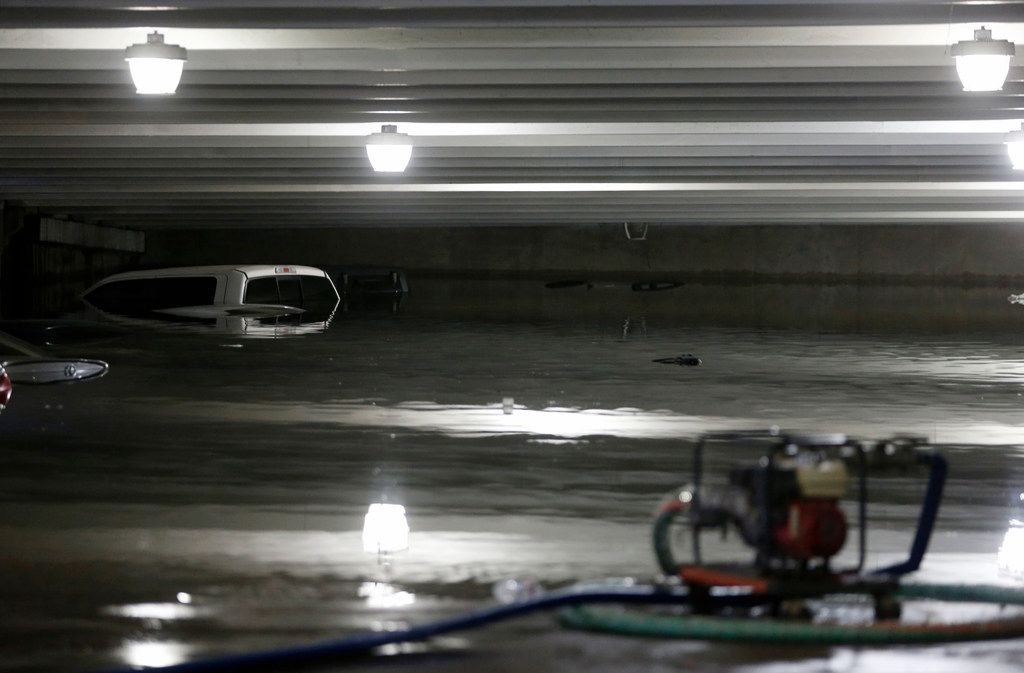 Water is pumped out of a flooded lower level parking garage A at Dallas Love Field under water due to heavy rains overnight in Dallas on Wednesday, April 23, 2019. The airport closed the lower level to traffic. Water is being pumped from the flooded areas by city staff employees. (Vernon Bryant/The Dallas Morning News)