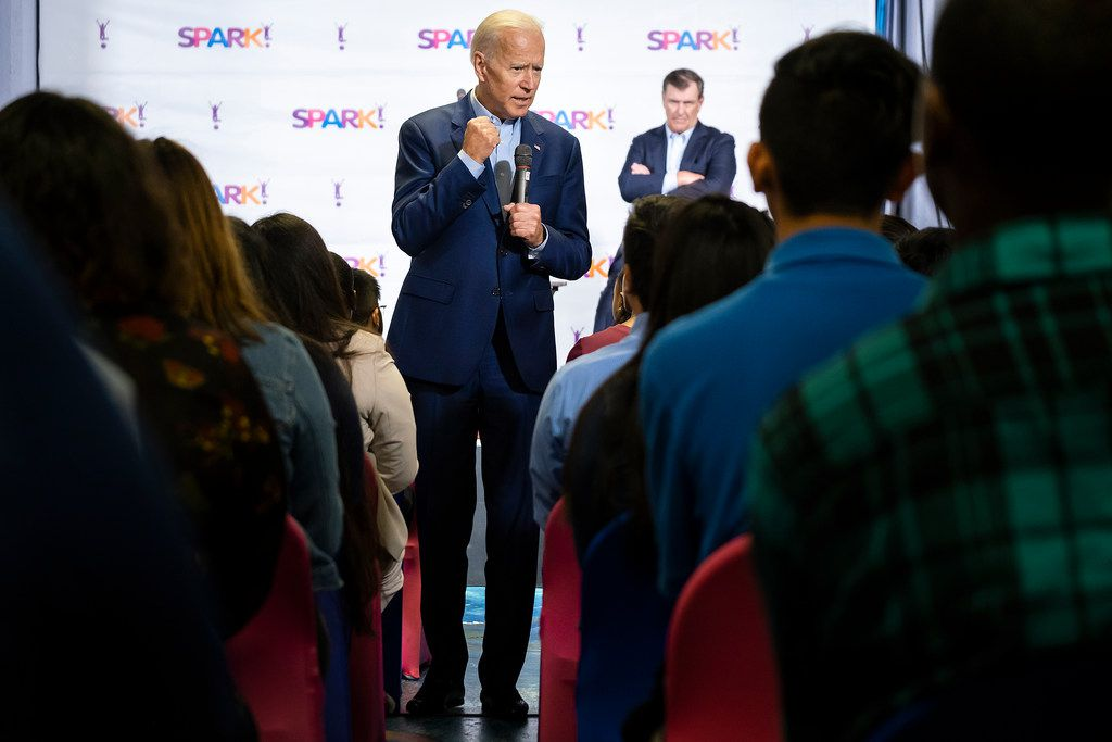 Democratic presidential candidate Joe Biden speaks to participants in the Dallas Mayor's Intern Fellows Program as Dallas Mayor Mike Rawlings looks on during a campaign event at SPARK! on Wednesday, May 29, 2019, in Dallas.