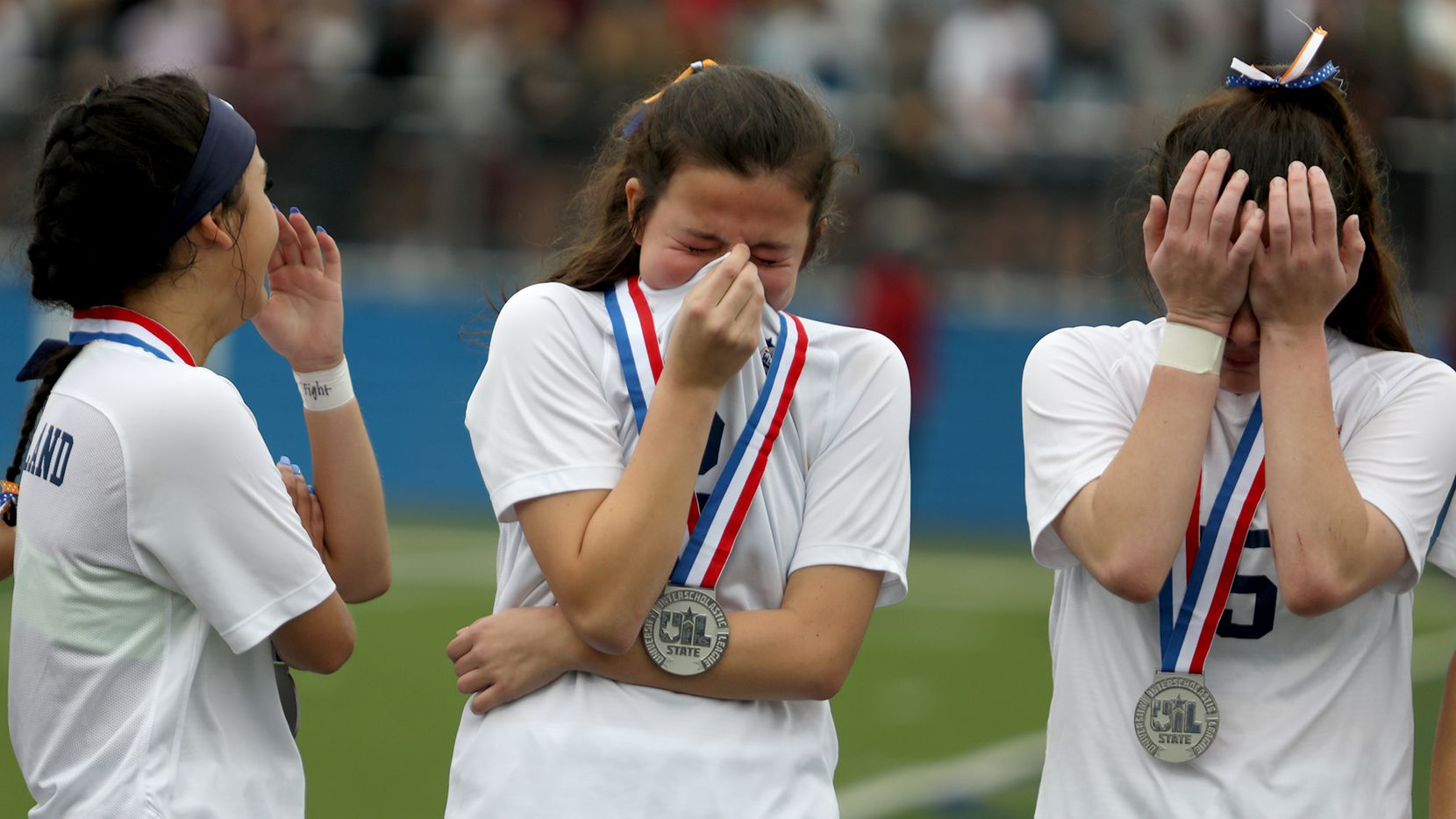 Wakeland's Natalie Cox (from left), Rachel Perry, and Ally Perry react after their UIL 5A girls State championship soccer game against Dripping Springs at Birkelbach Field on April 16, 2021 in Georgetown, Texas. Dripping Springs won 2-1.