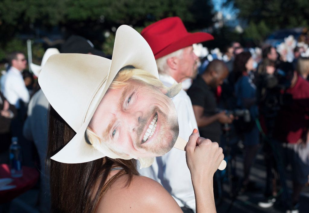 Guests attending the ground breaking for Richard Brasons Virgin Hotel in the Design District use his face to block the sun on Monday, Oct. 17, 2016   (Rex C. Curry/Special Contributor)
