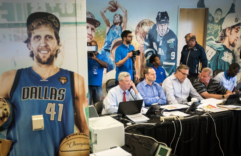 "FILE - Seated at the table from left, Mavericks assistant GM Keith Grant, director of scouting Jason White, president of basketball operations/GM Donnie Nelson, director of player personnel Tony Ronzone and assistant VP of basketball operations Michael Finley huddle in the team's ""war room"" during the 2017 NBA draft at American Airlines Center on Thursday, June 22, 2017, in Dallas."