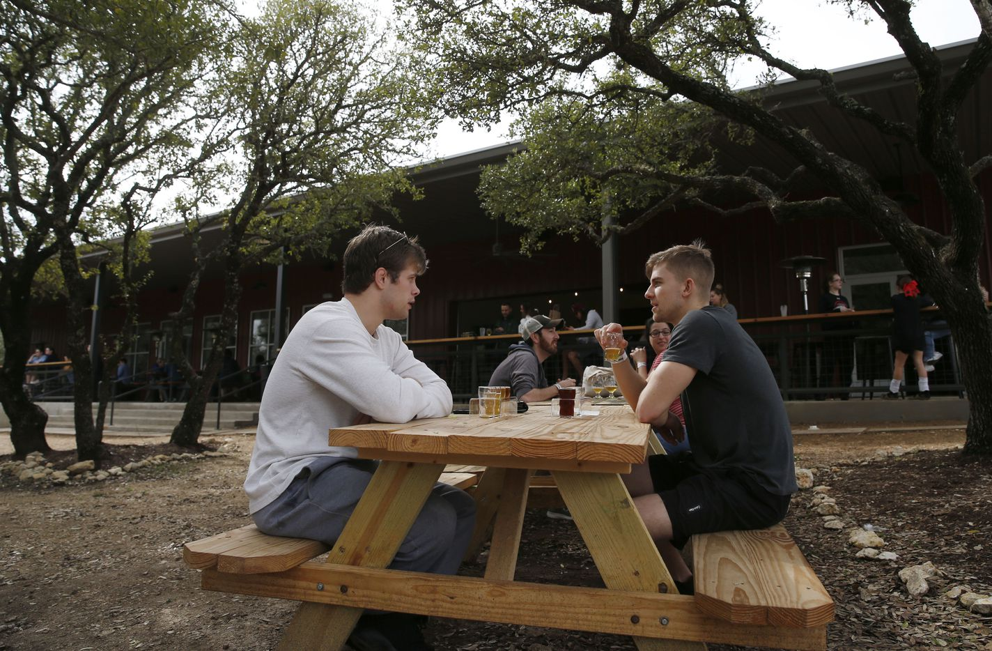 Robert Hughes (left) of Houston and Ty Jacobs of Saginaw share time at Family Business Beer Company.