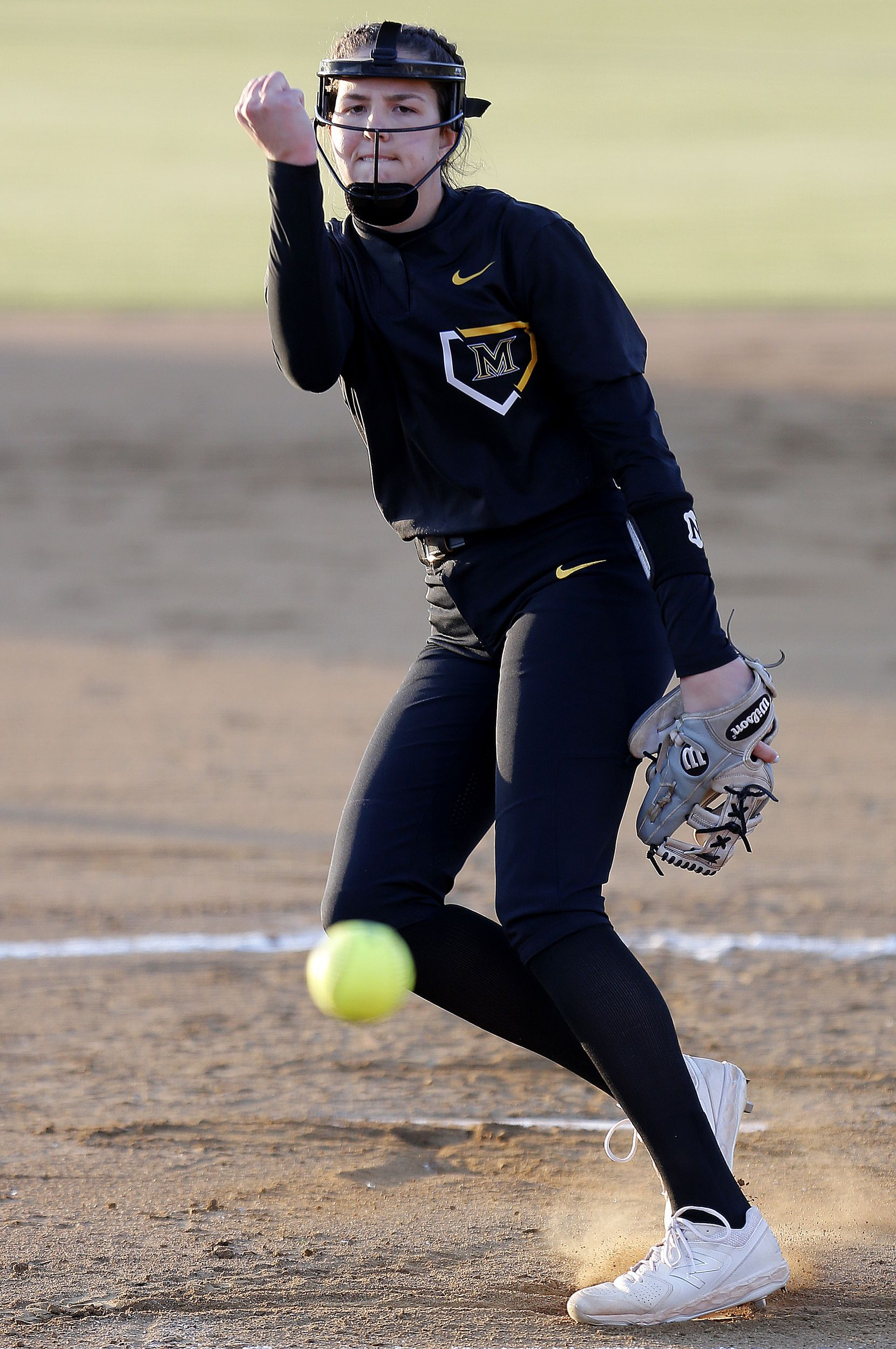 Memorial pitcher Maddie Muller (13) delivers a pitch in the first inning as Heritage High School hosted Memorial High School for the District 9-5A softball championship in Frisco on Tuesday, April 20, 2021. (Stewart F. House/Special Contributor)