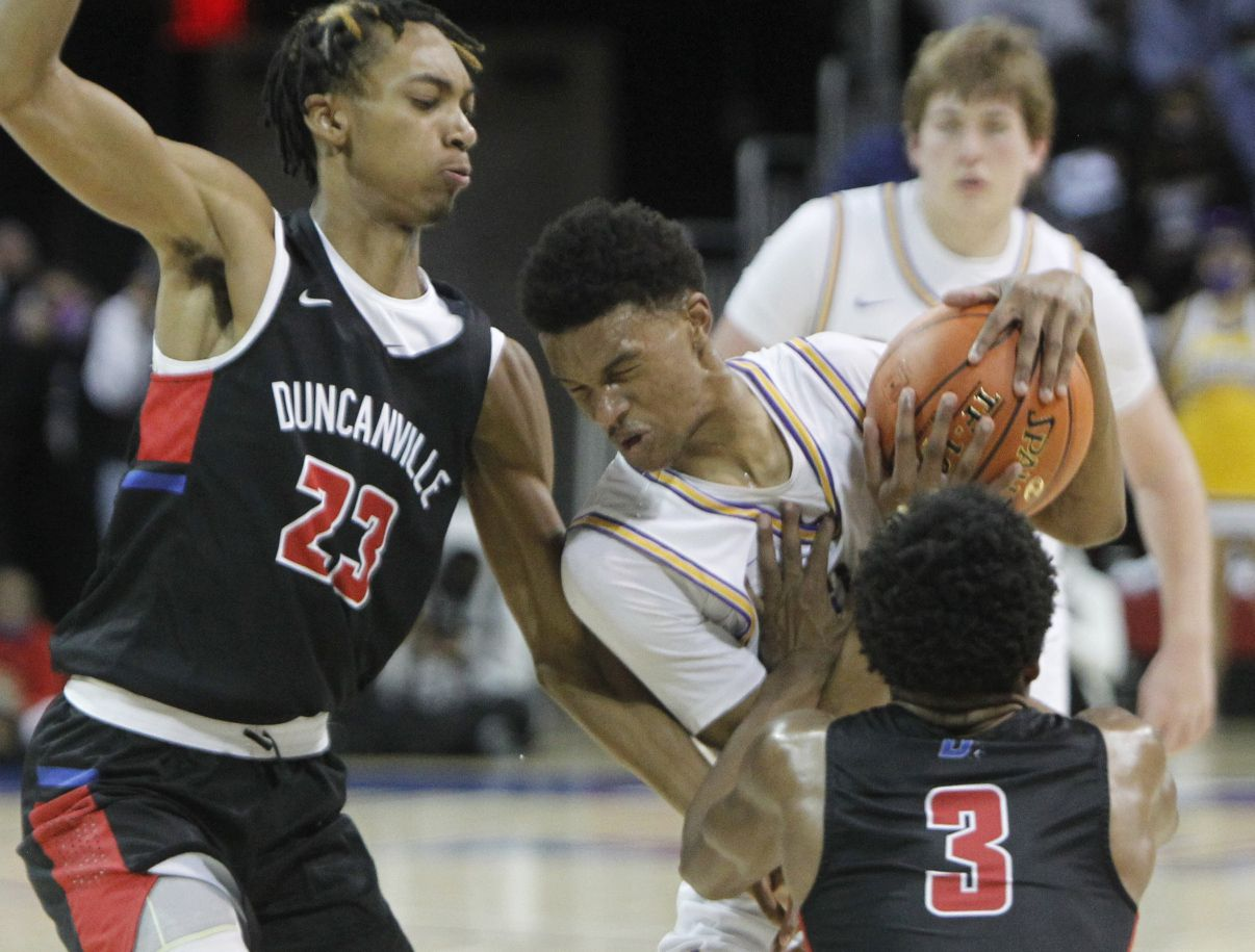 Richardson guard Rylen Griffen (3) winces as he runs into heavy traffic as he drives the lane and is met by Duncanville guard C.J. Ford (3) and Cameron Barnes (23) during the final quarter of play. Duncanville won 68-49 to advance. The two teams played their Class 6A state semifinal boys basketball playoff game at Moody Coliseum on the campus of SMU in Dallas on March 9, 2021. (Steve Hamm/ Special Contributor)