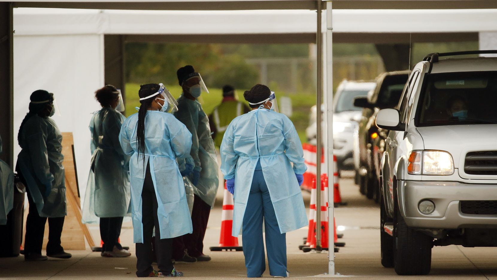 Medical personnel prep and conduct nasal swab tests at a drive-thru COVID-19 testing site at Dallas College Eastfield Campus in Mesquite, Monday, August 3, 2020. The mobile testing center moved from the University of Dallas to Eastfield. (Tom Fox/The Dallas Morning News)