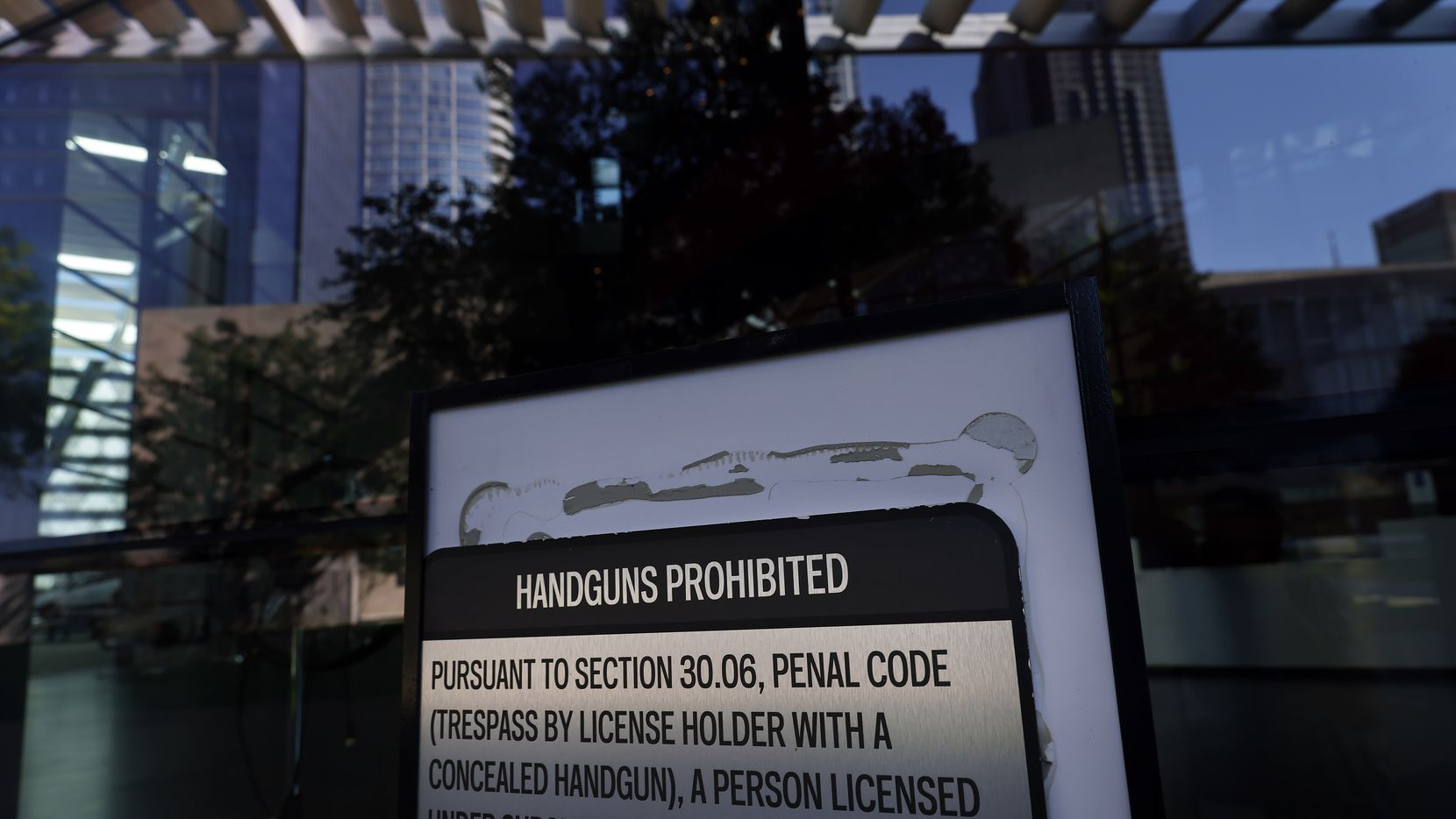 In addition to signage banning guns (shown here on Aug. 31) in downtown Dallas' AT&T Performing Arts Center, guests are also screened for weapons at its venues.