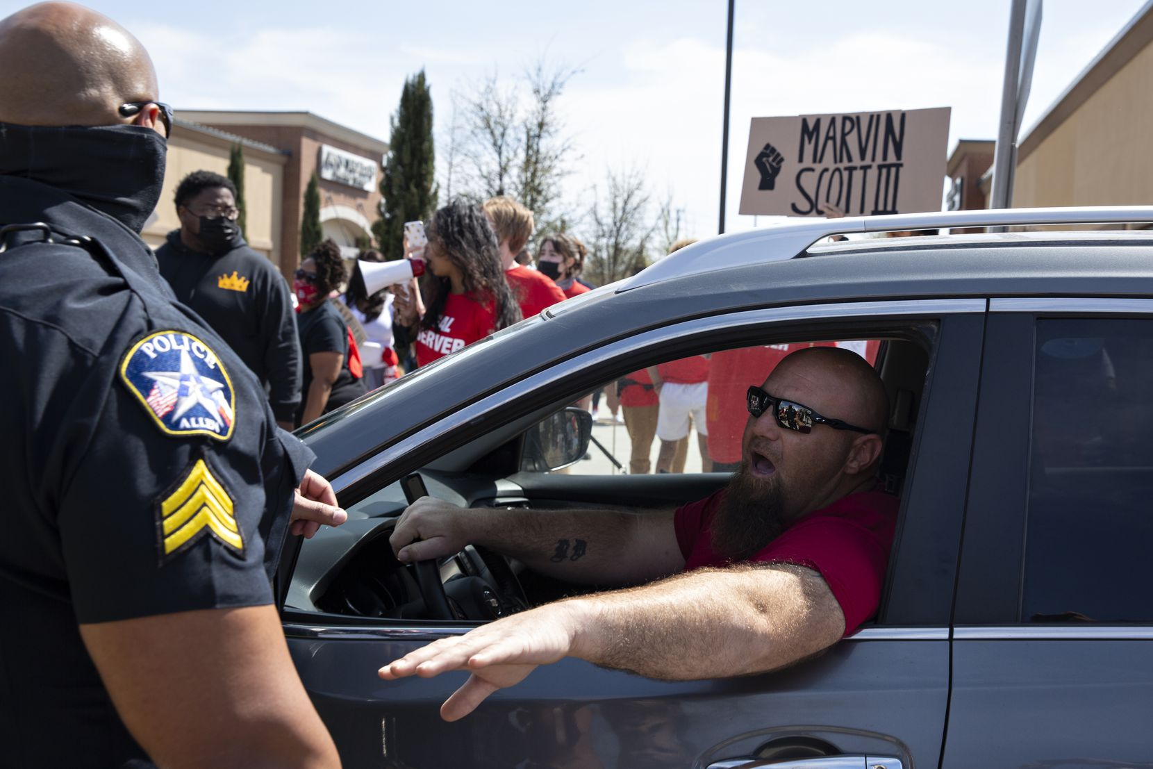 A driver gets frustrated with the traffic caused by a march through the Allen Outlets on Sunday, March 21, 2021 demanding justice for Marvin Scott III, who died a week prior while in custody at the Collin County Jail on March 14, 2021. (Shelby Tauber/Special Contributor)
