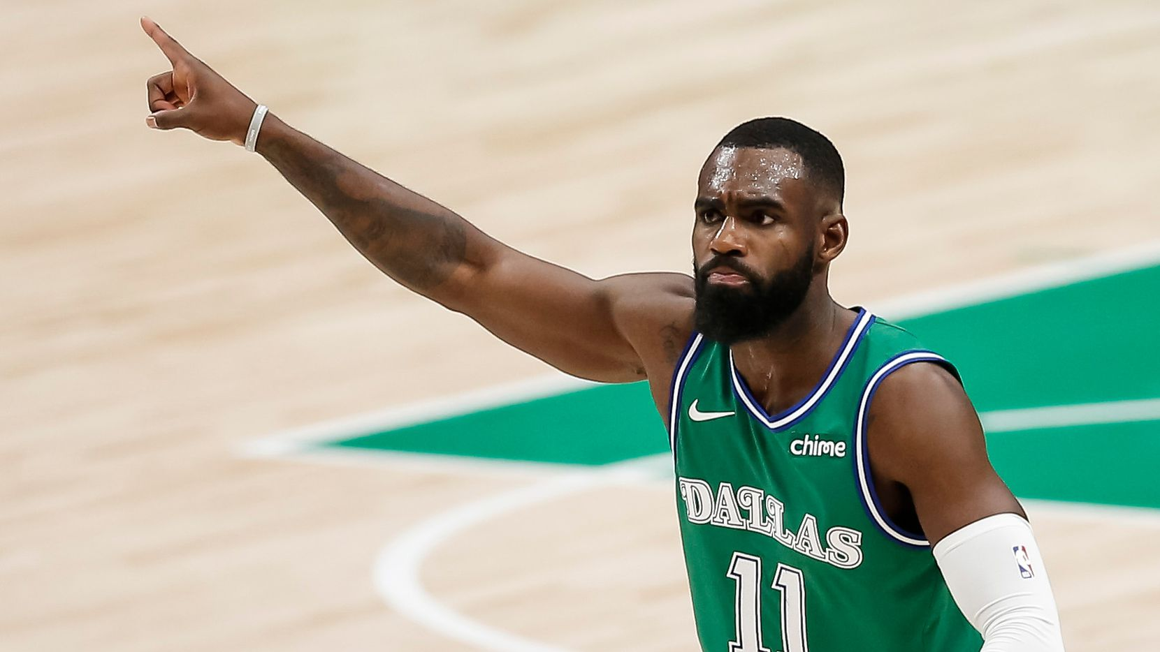 Dallas Mavericks forward Tim Hardaway Jr. (11) celebrates scoring a three-point shot during the second half of an NBA basketball game in Dallas, Monday, February 22, 2021. Hardaway scored 29 points in the game. Dallas won 102-92.