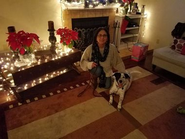 Isabelle Papadimitriou, 64, poses with her dog Shadow. Papadimitriou was a rehabilitation respiratory therapist for Baylor Scott & White Health in Dallas. She died July 4 of COVID-19