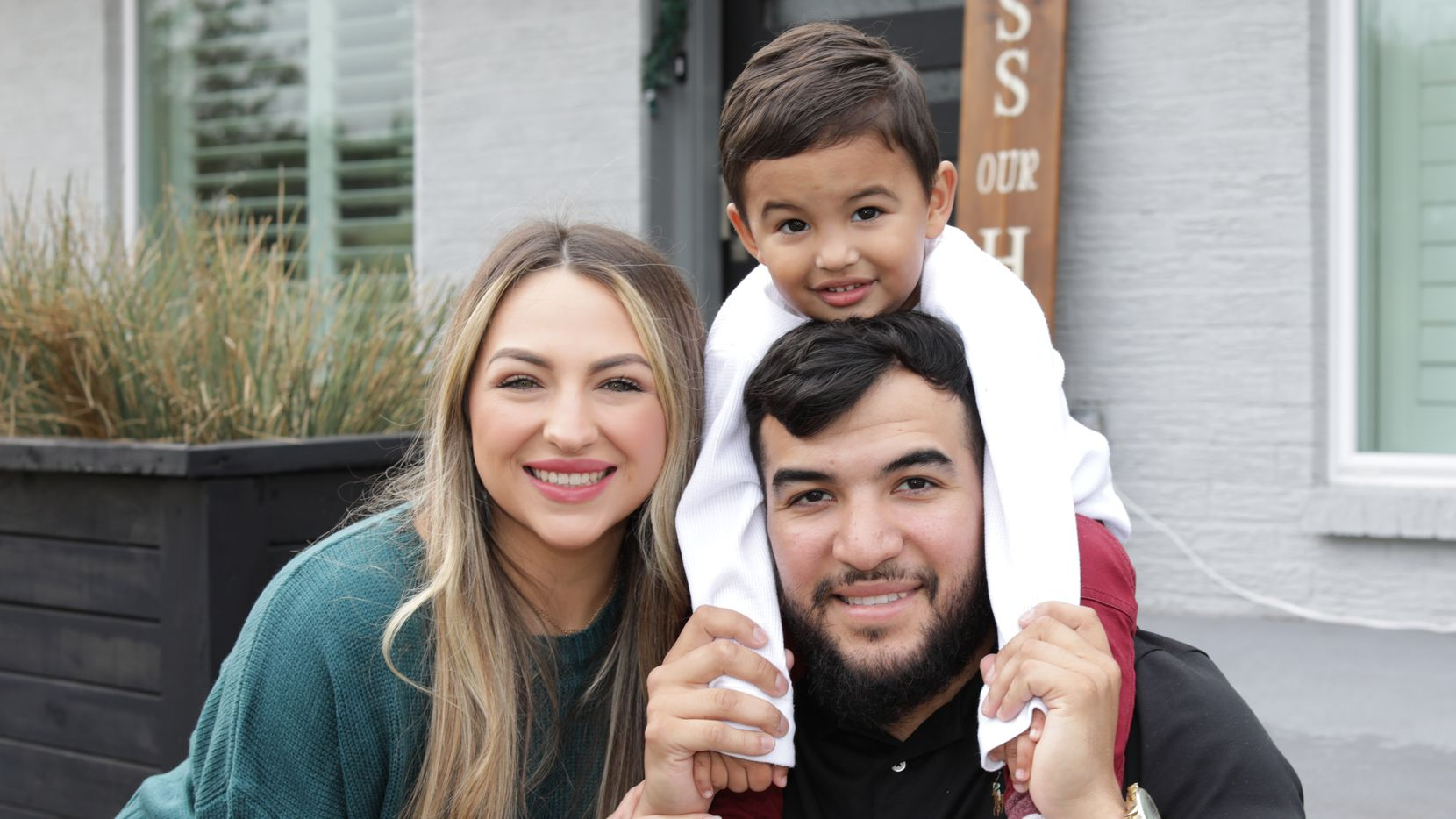 Texas Rangers catcher Jose Trevino, pictured with Markie Mandel and their son, Josiah Trevino, has expanded his family's annual toy drive to Frisco.