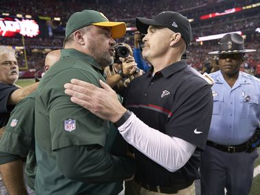Green Bay Packers coach Mike McCarthy (L) shaking hands with Atlanta Falcons coach Dan Quinn after game at Georgia Dome.