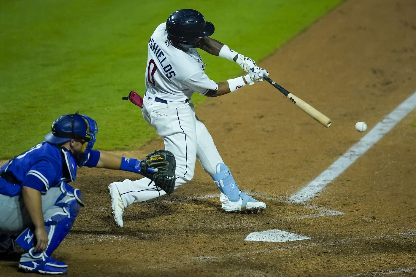Round Rock Express outfielder Delino DeShields drives in two runs with a double during the seventh inning against the Oklahoma City Dodgers at Dell Diamond on Thursday, May 6, 2021, in Round Rock, Texas.