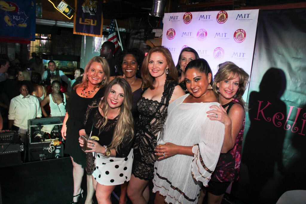 Kellie Rasberry poses with her friends at her birthday bash at Big Al's McKinney Ave Tavern on April 16, 2015.