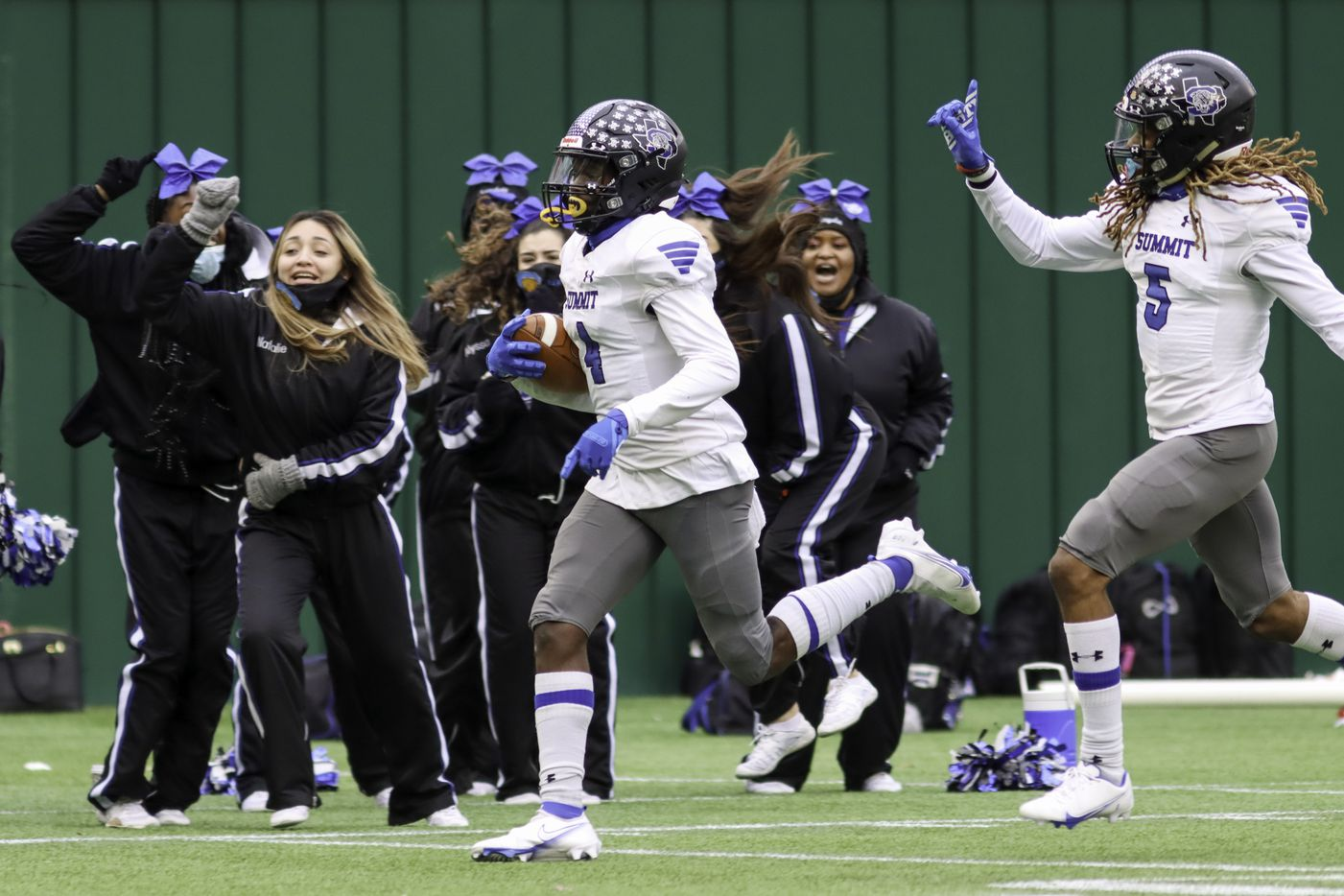 Mansfield Summit defensive back Jalon Rock (4) returns a kickoff for a touchdown alongside defensive back Sean Smith (5) during the second half against Red Oak at Globe Life Park in Arlington, Texas, Friday, Jan. 1, 2021. (Elias Valverde II / Special Contributor)