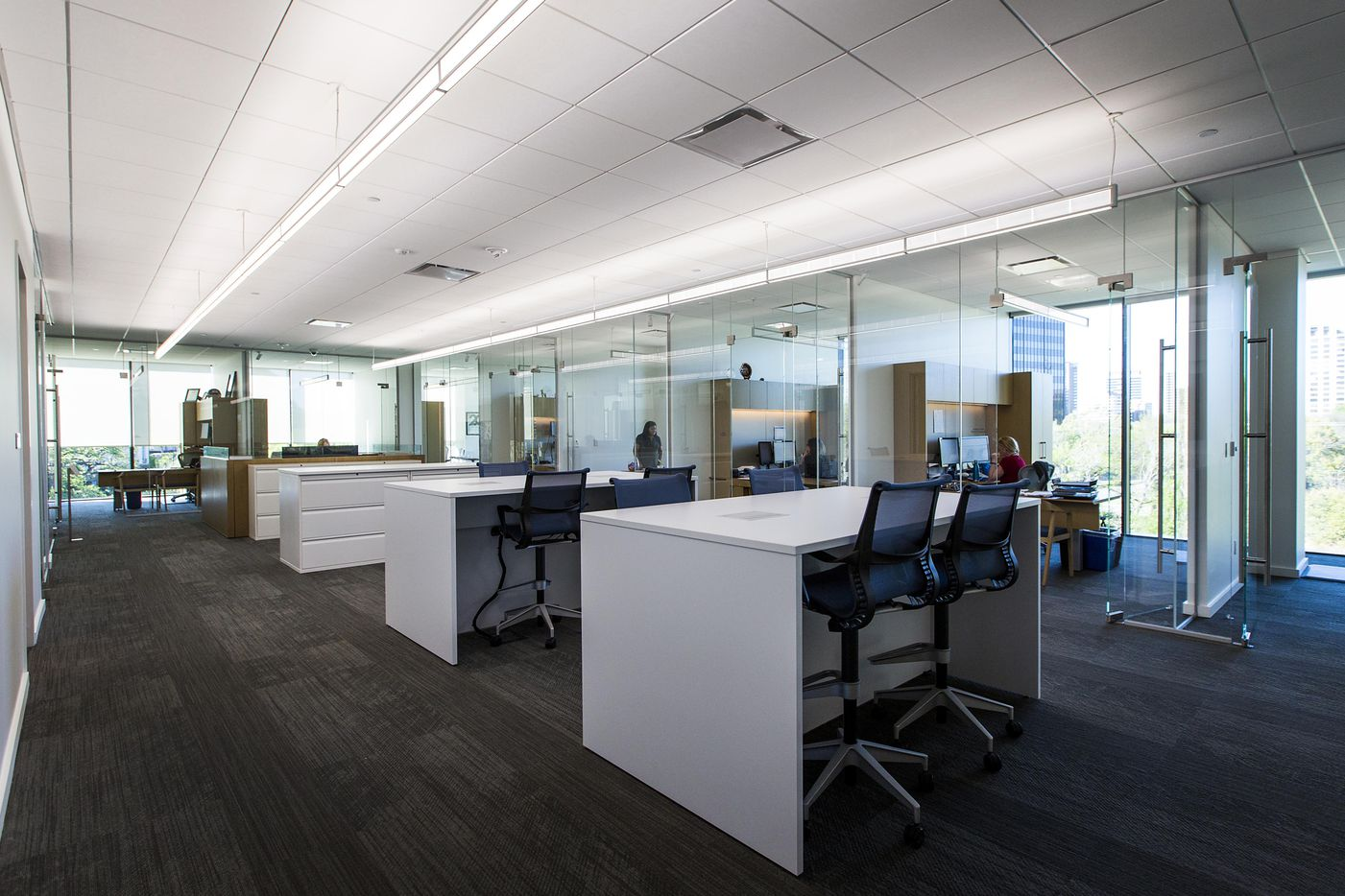Community desks and offices seen during a tour of the new headquarters for the Perot family businesses.
