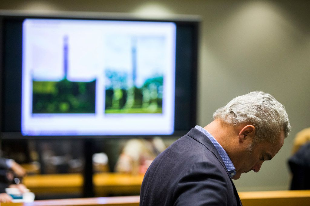 Chris Carter stands in line to speak in the public hearing forum at the Dallas Landmark Commission, before they voted to remove the Confederate War Memorial that currently stands in front of the downtown convention center on Monday, March 4, 2019 at Dallas City Hall. Images of the memorial are displayed behind Carter. (Ashley Landis/The Dallas Morning News)