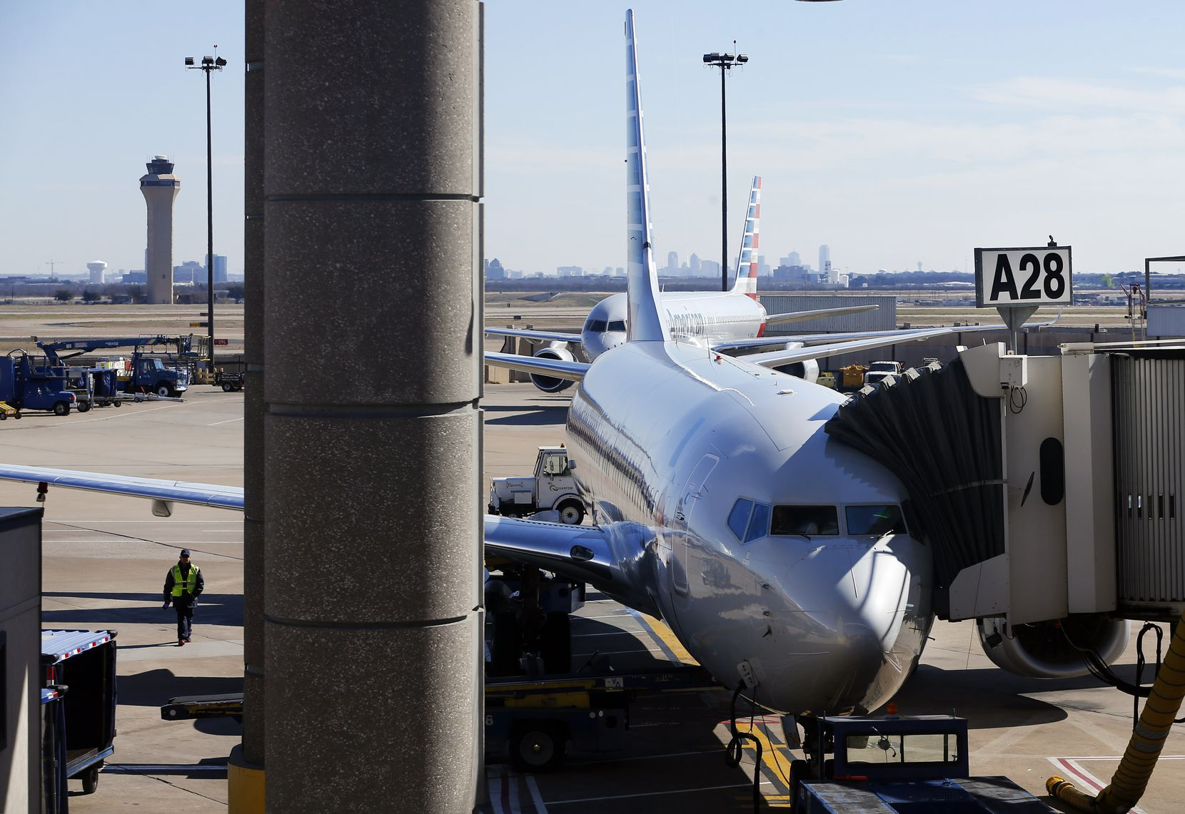 An American Airlines plane is parked at a Terminal A gate at Dallas-Fort Worth International Airport.