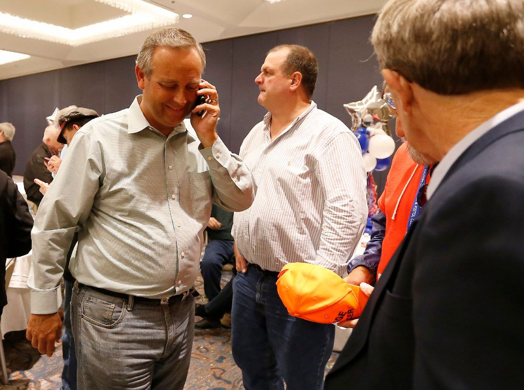 GOP state Rep. Rodney Anderson (left) talks on his cell phone as he walks in to make a victory speech at a Dallas County Republican watch party at the Westin Dallas Park Central hotel Tuesday.