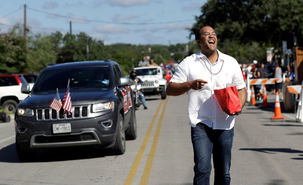 FILE - In this Aug. 27, 2016, file photo, first-term Republican Rep. Will Hurd of Texas, hands out candy and beads as he takes part in a parade in Helotes, Texas. Hurd faces former Democratic Rep. Pete Gallego in Texas' 23rd District, which spans 58,000-plus square miles, making it larger than 29 states. Neither Hurd nor Gallego live in the district. (AP Photo/Eric Gay, File)