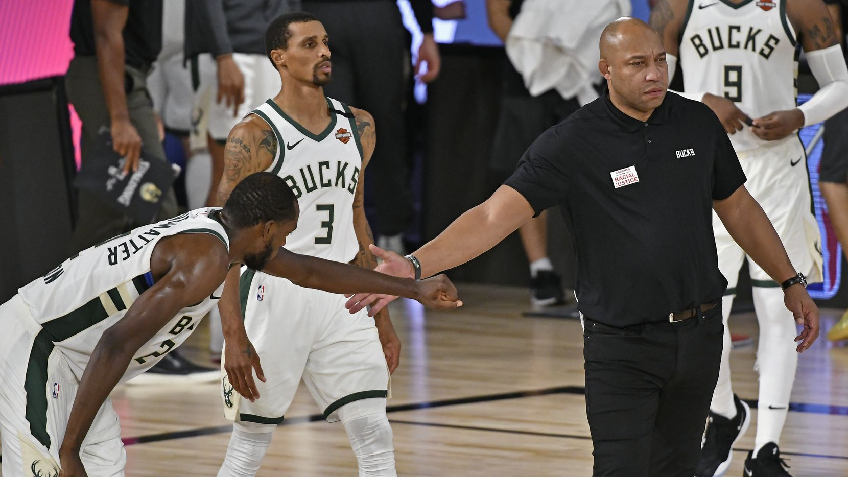 Assistant Coach, Darvin Ham of the Milwaukee Bucks high fives a player during the game against the Miami Heat during Game Five of the Eastern Conference Semifinals of the NBA Playoffs on September 8, 2020 at The Field House at ESPN Wide World Of Sports Complex in Orlando, Florida.