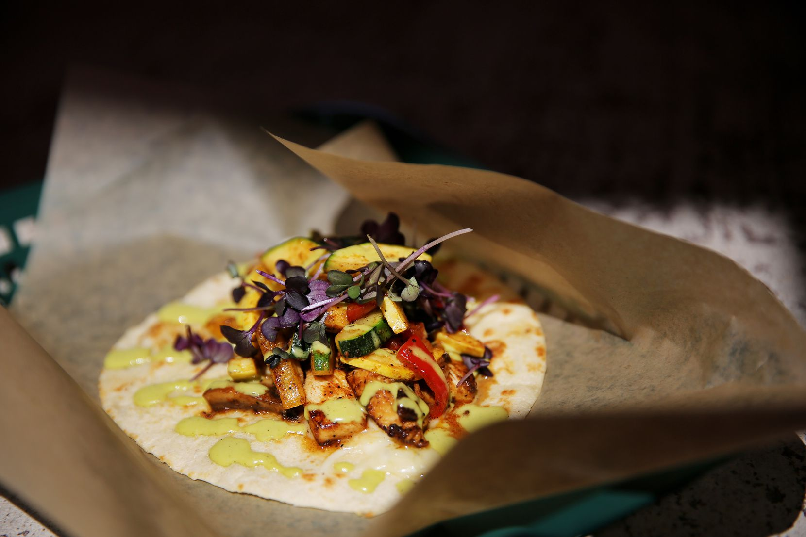 The La Prensa taco from Tacos Mariachi was made with grilled chicken, sauteed vegetables, asadero cheese, jalapeño aioli and microgreens.
