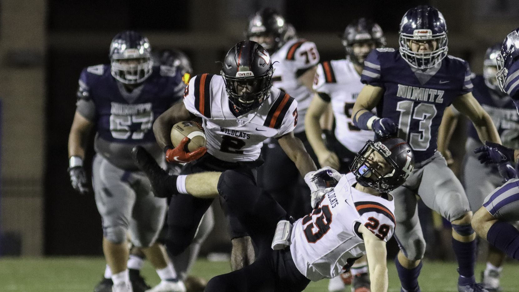 Lake Highlands running back Noelle Whitehead (2) collides with wide receiver Ryan Lucas (29) during the first half against Irving Nimitz at Ellis Stadium in Irving, Friday, November 20, 2020.
