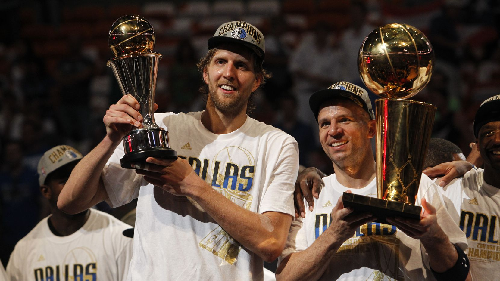Dallas Mavericks power forward Dirk Nowitzki (41), holding the Bill Russell NBA Finals MVP trophy, and Dallas Mavericks point guard Jason Kidd (2) with the Larry O'Brien NBA Championship Trophy pose on the podium after winning the NBA Finals at American Airlines Arena Sunday, June 12, 2011 in Miami. Mavs won 105-95.