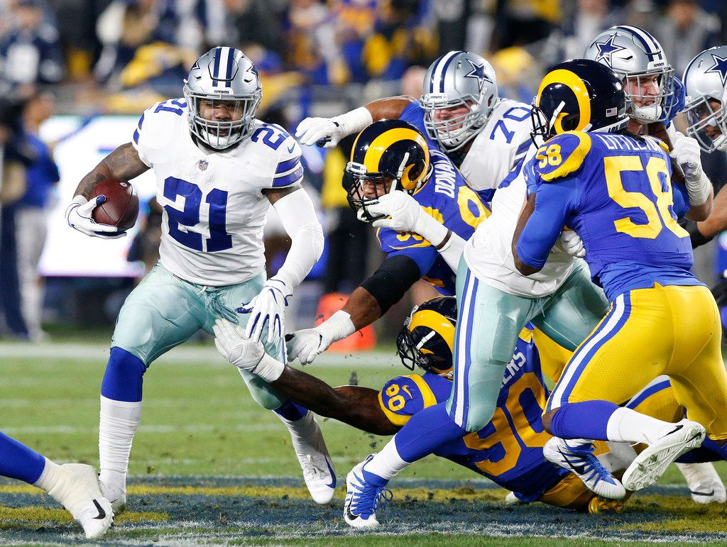 Dallas Cowboys running back Ezekiel Elliott (21) picks up the first down as the Cowboys went for it on 4th and 1 against the Los Angeles Rams in the first quarter of their NFC Divisional Playoff game at Los Angeles Memorial Coliseum in Los Angeles, Saturday, January 12, 2019. (Tom Fox/The Dallas Morning News)
