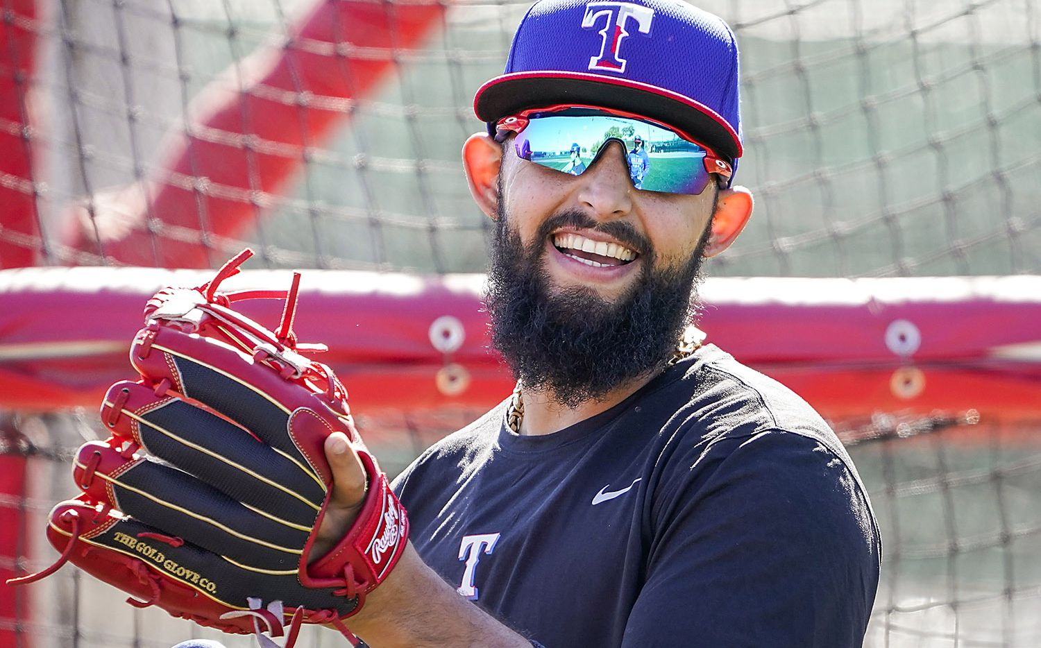 Texas Rangers second baseman Rougned Odor laughs with teammates during a spring training workout at the team's training facility on Friday, Feb. 14, 2020, in Surprise, Ariz.