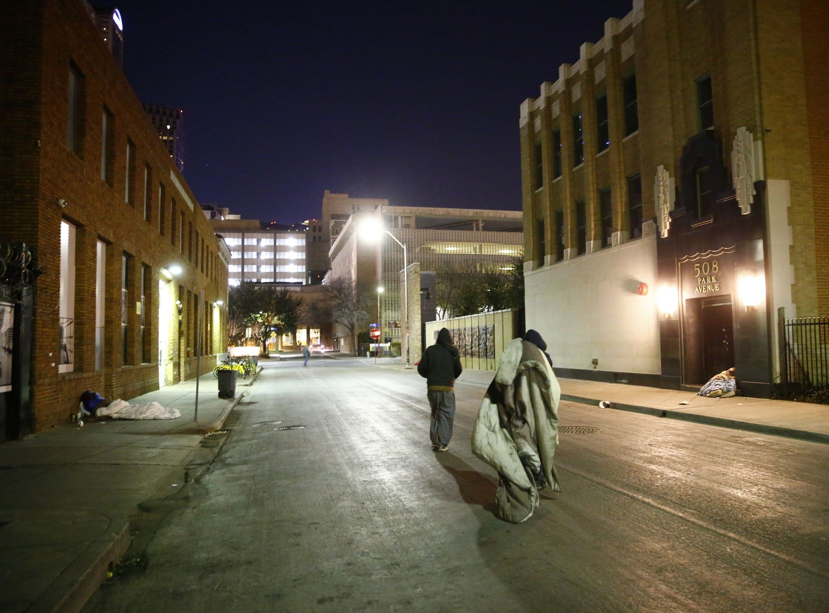 People moved their blankets down Park Avenue next to The Stewpot in downtown Dallas on Tuesday night.