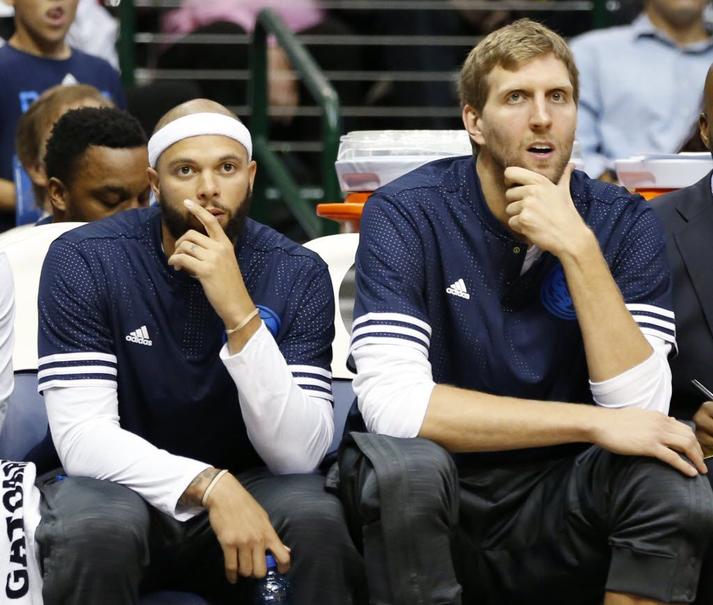 Dallas Mavericks guard Deron Williams (8) and Dallas Mavericks forward Dirk Nowitzki (41) watch from the game against the Denver Nuggets from the bench in the first half of play at American Airlines Center in Dallas on Tuesday, October 6, 2015.(Vernon Bryant/The Dallas Morning News)