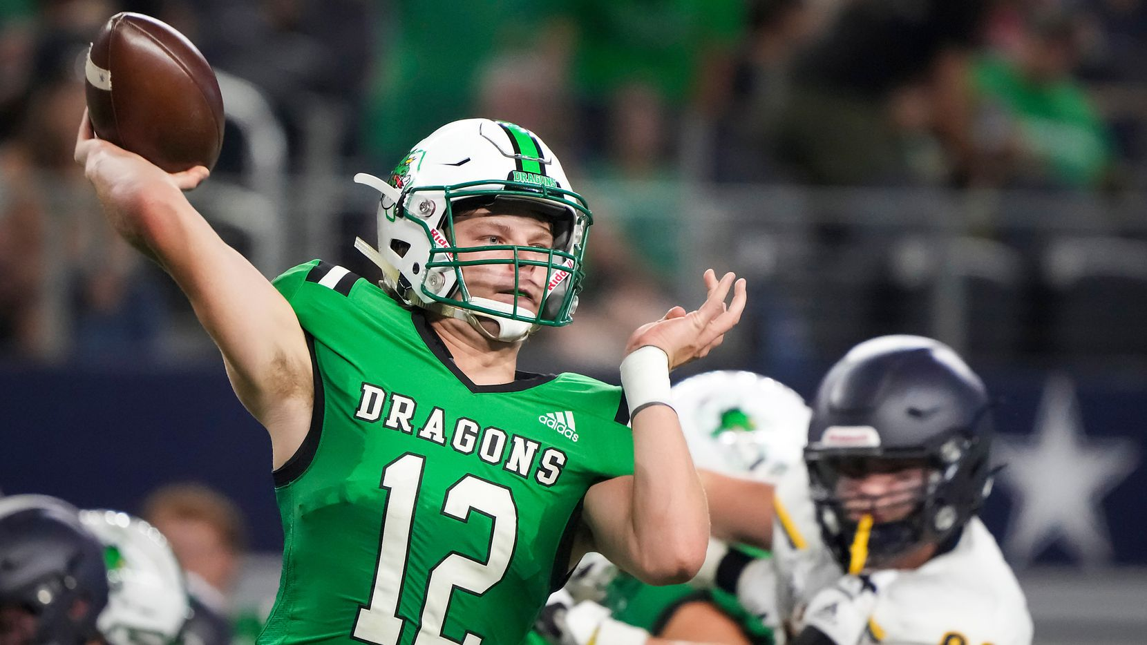 Southlake Carroll quarterback Kaden Anderson (12) throws a pass during the first half of a high school football game against Highland Park at AT&T Stadium on Thursday, Aug. 26, 2021, in Arlington. (Smiley N. Pool/The Dallas Morning News)
