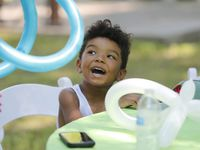 Asher Coleman, 3, waits with anticipation for his balloon creation as For Oak Cliff held a grand opening event for for their newly acquired building on Saturday, June 19,. The building is the former Moorland YMCA.