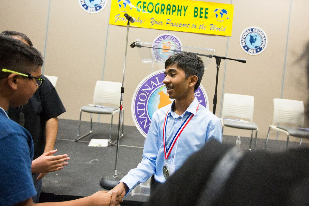 Pranay Varada, Texas' previous state champion, is congratulated after winning the final round of the State Geography Bee on March 31, 2017, at the Pat May Professional Development Center in Bedford, Texas. (Special Contributor/Andrew Buckley)